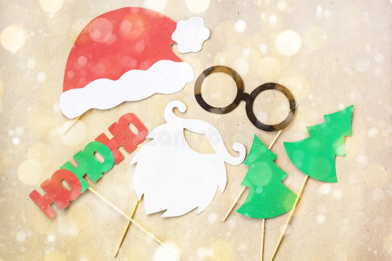 Photo booth colorful props for christmas party - mustache, santa claus, fir tree, glasses, hat decorated with snow stock photos
