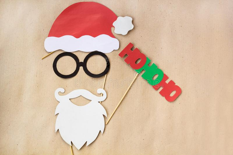 Photo booth colorful props for christmas party - mustache, santa claus, glasses, hat royalty free stock photography