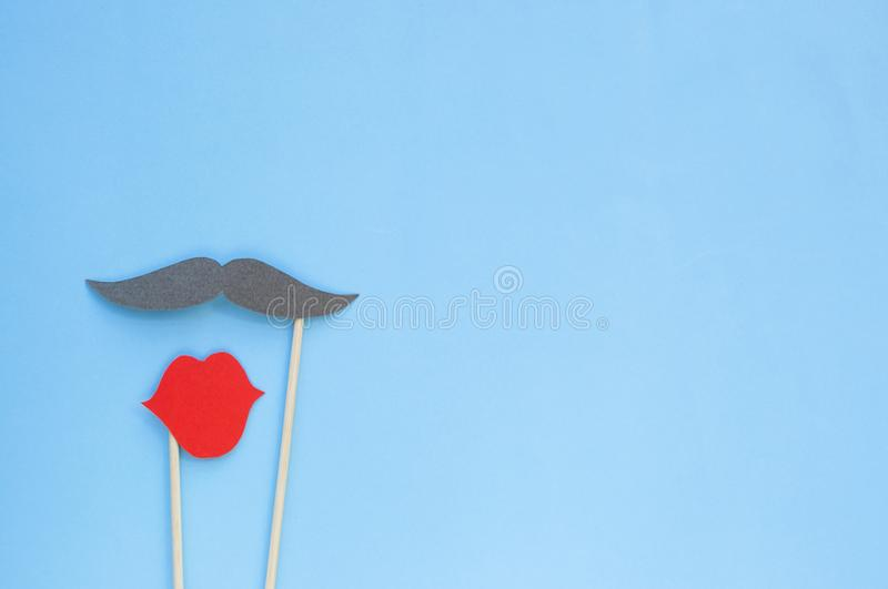 Photo booth props moustache and lips on blue background. royalty free stock photos