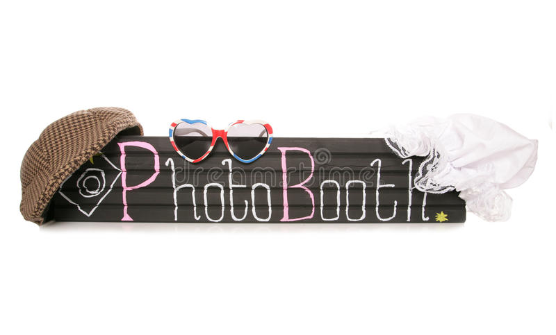 Photo booth sign with fancy dress hats stock photo