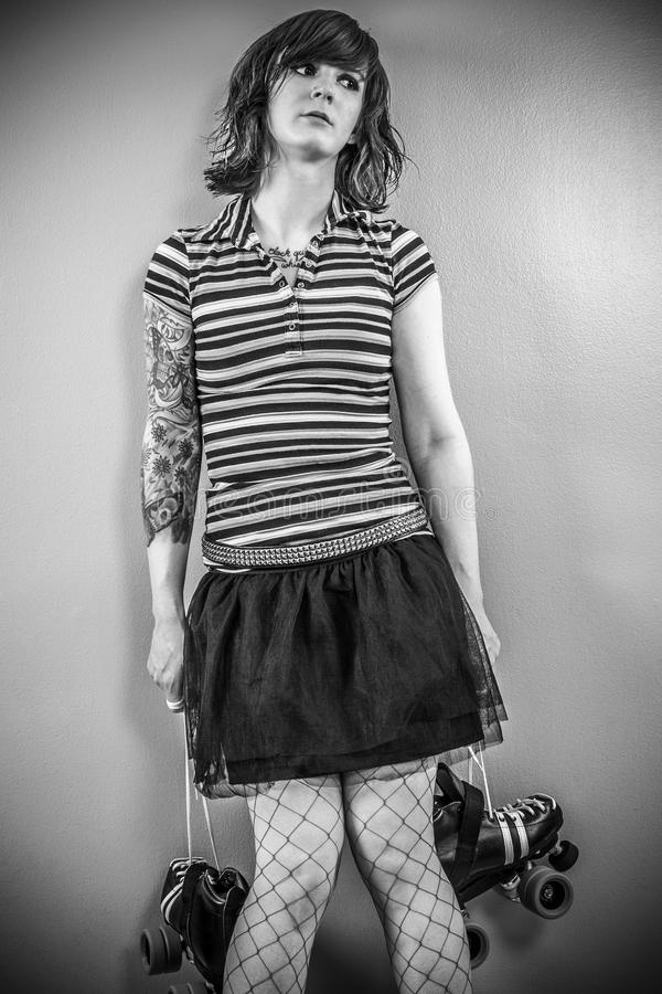 Download Bored Roller Derby Woman Waiting Stock Photo - Image of rollerderby, rollerskating: 107306718