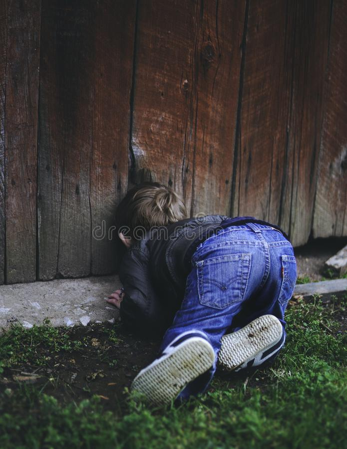 Photo of Boy Peeking on Brown Wooden Fence stock photography