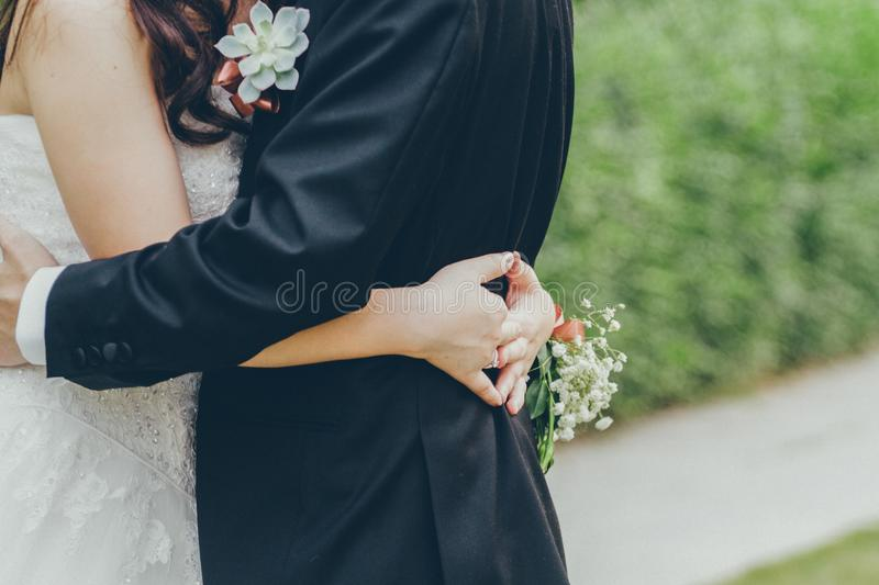 Photo of Bride and GroomHugging royalty free stock photos