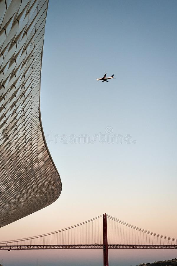 Photo the bridge on April 25 against the MAAT Museum in Portugal. The evening sunset. stock image