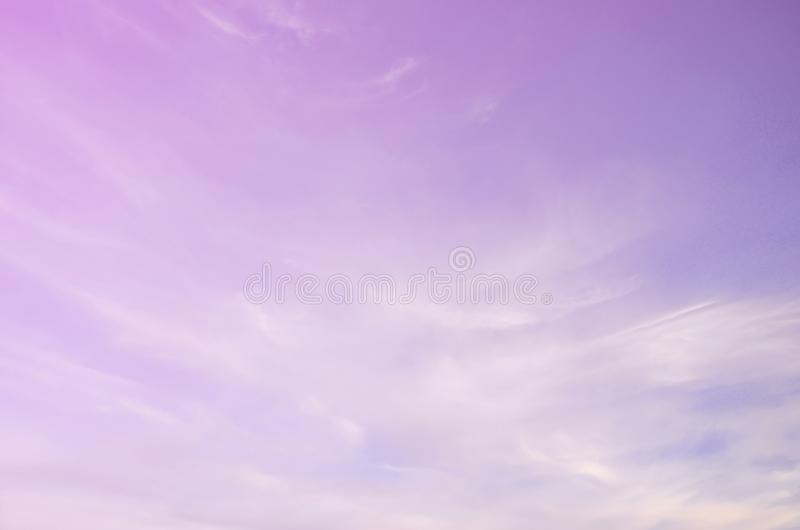 A photo of a bright and shiny blue sky with fluffy and dense whi stock photos