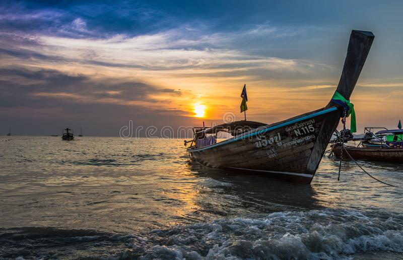 Photo of Brown Boat at Sea during Golden Hour royalty free stock image