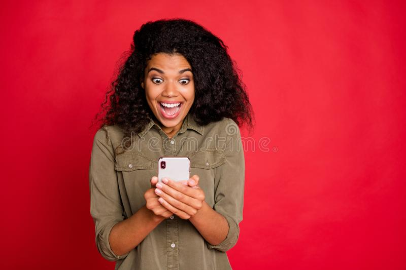 Photo of brown haired cheerful excited overjoyed screaming girlfriend browsing through her telephone finding lots of. Photo of brown haired cheerful excited royalty free stock photography