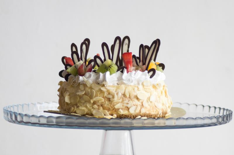 Photo of Brown and White Icing Covered Cake With Kiwi stock photo