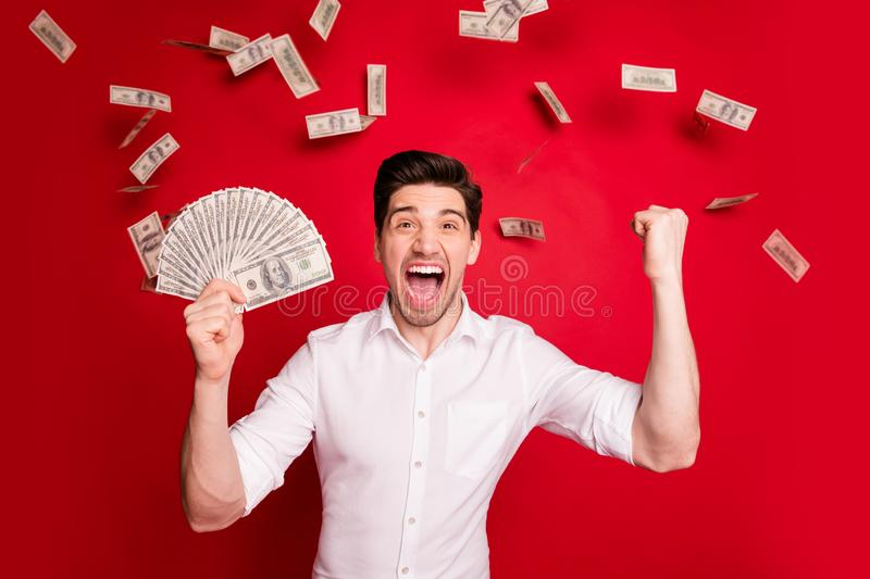 Photo of brunet white wealthy rich man enjoying his success while isolated with red background. Photo of brunet white wealthy rich man, enjoying his success stock photos