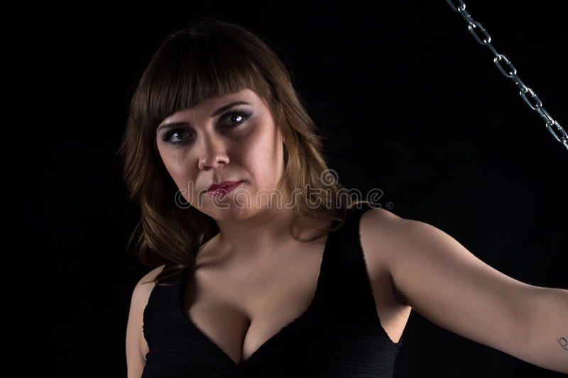 Photo of brunette woman and chain stock photo