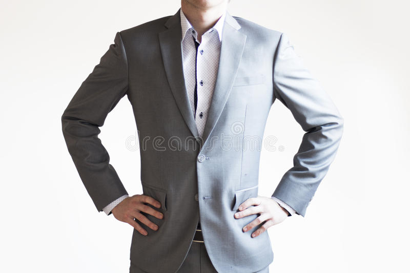 Photo of a businessman in grey suit standing in confident pose o royalty free stock photos