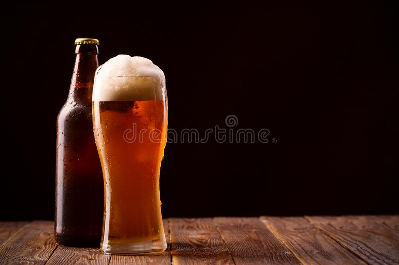 Photo of buttle and glass of beer royalty free stock image