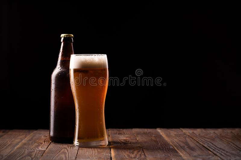 Photo of buttle and glass of beer stock photos