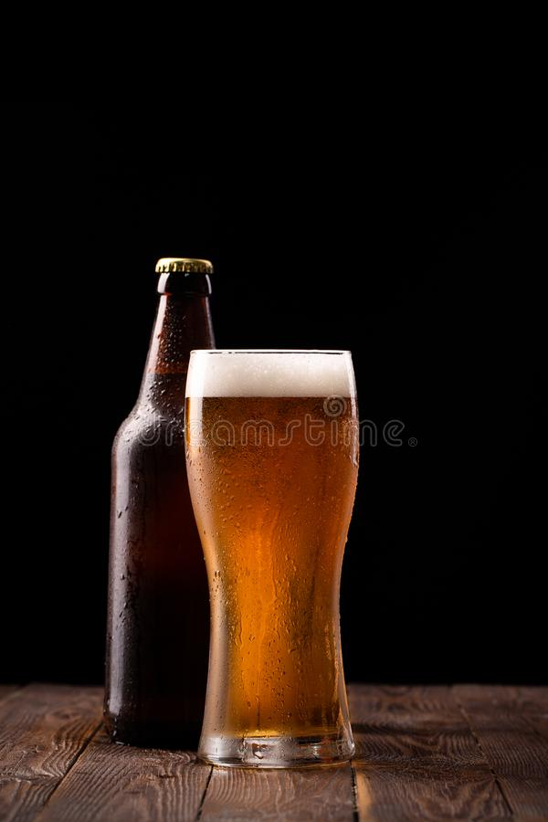 Photo of buttle and glass of beer royalty free stock photography