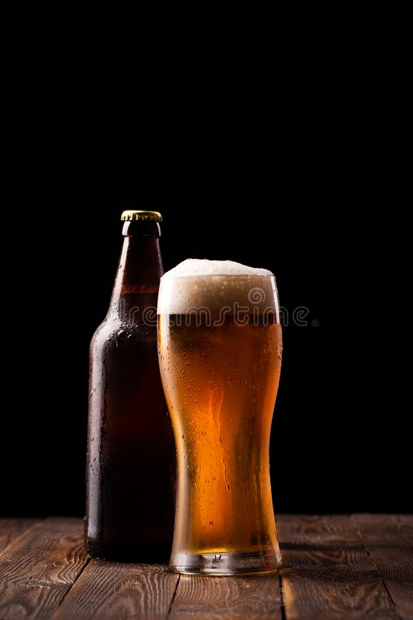 Photo of buttle and glass of beer stock images