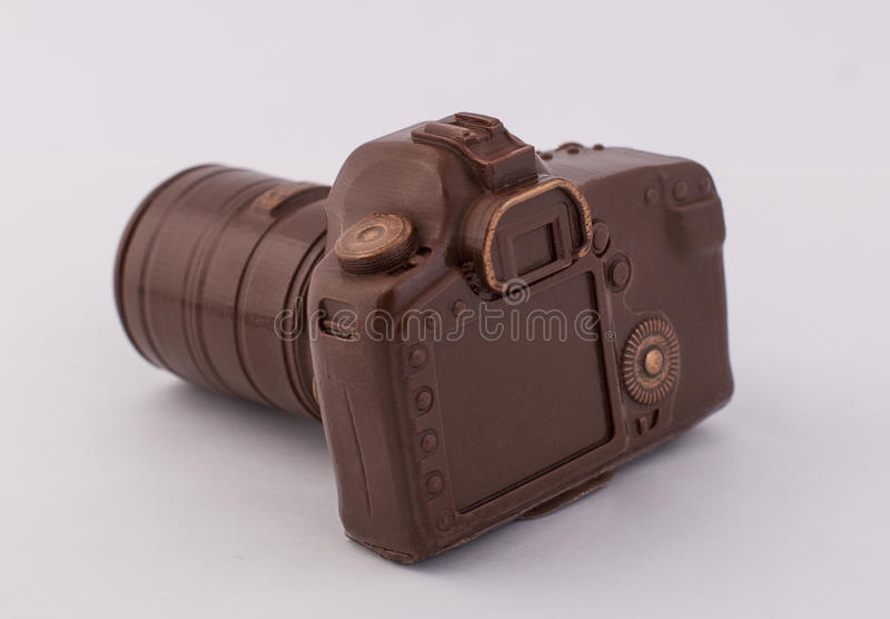 Photo camera. Chocolate taste photo camera Canon brown royalty free stock image