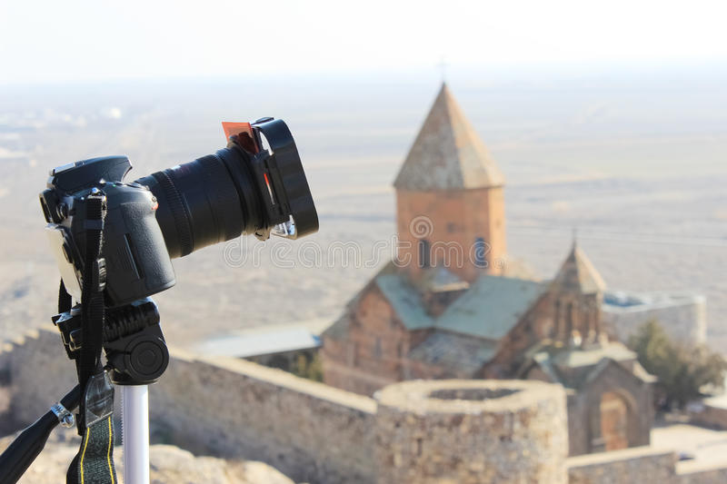 Photo camera with church background royalty free stock photography