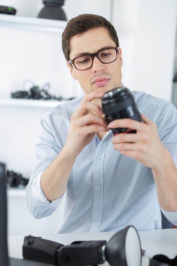 Photo camera lens repair maintenance support royalty free stock image