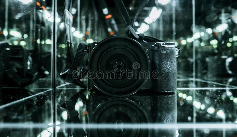 Photo camera in the mirror cube. With colorful stock photography