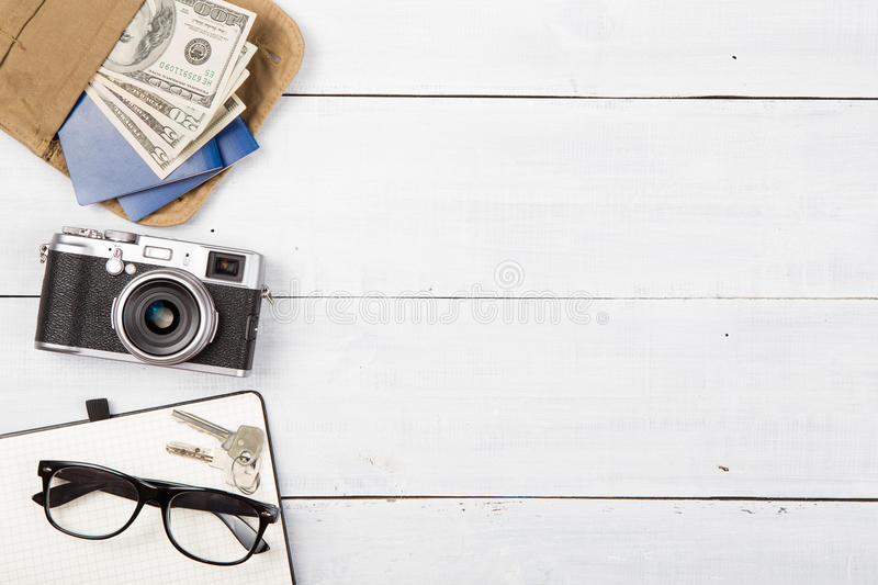 Photo camera and set of cool stuff on wooden background. Photo camera and set of cool stuff stock photo