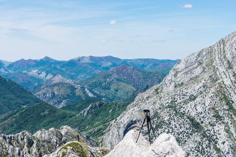 Photo camera with tripod in mountain landscape stock photos