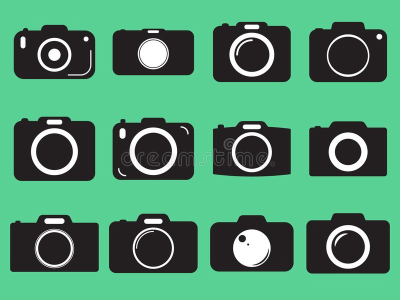 Photo camera vector icon. On green background royalty free illustration