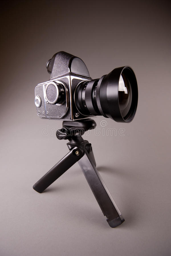 Free Photo Camera With Tripod On Grey In Hi-Res Stock Images - 13311584