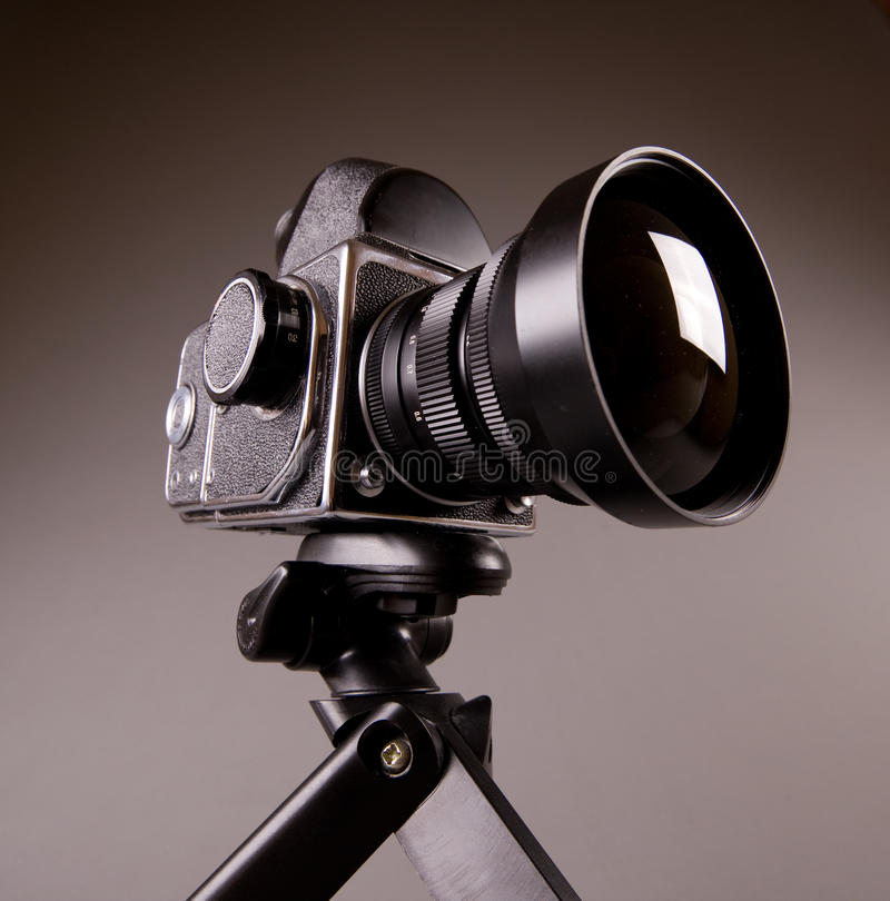 Free Photo Camera With Tripod On Grey In Hi-Res Royalty Free Stock Photo - 13311585
