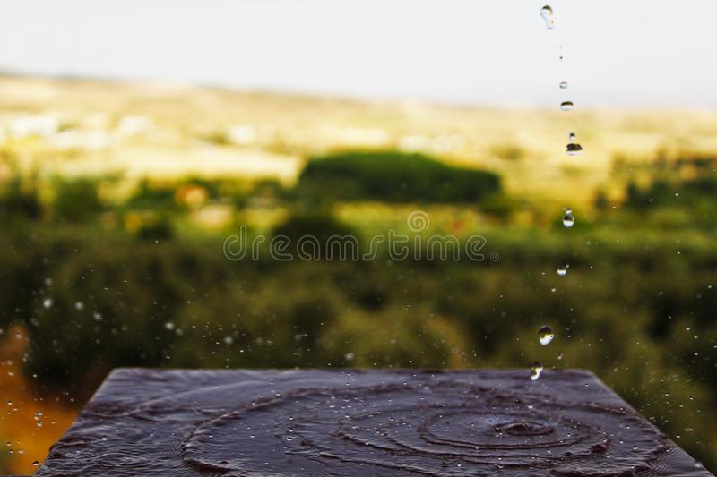 Waves that describe a jet of water stock photos