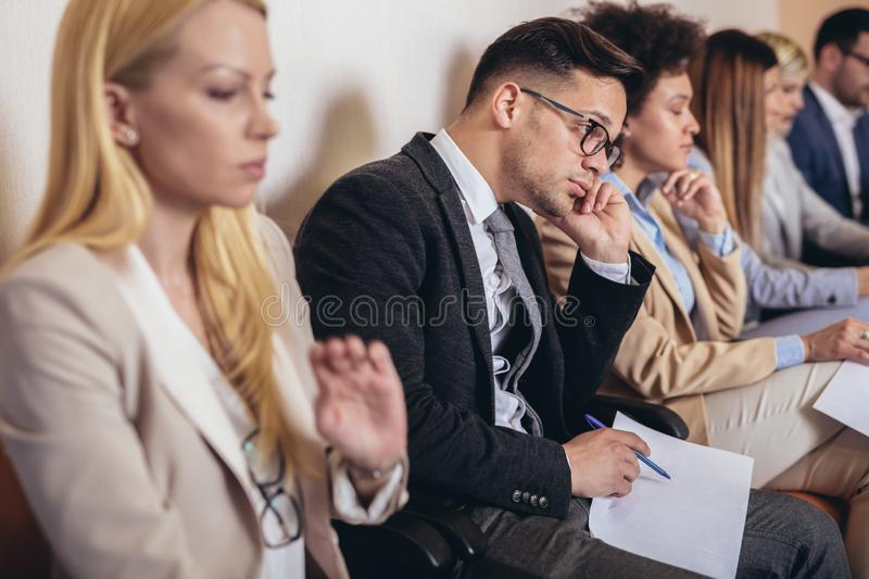 Photo of candidates waiting for a job interview. royalty free stock image