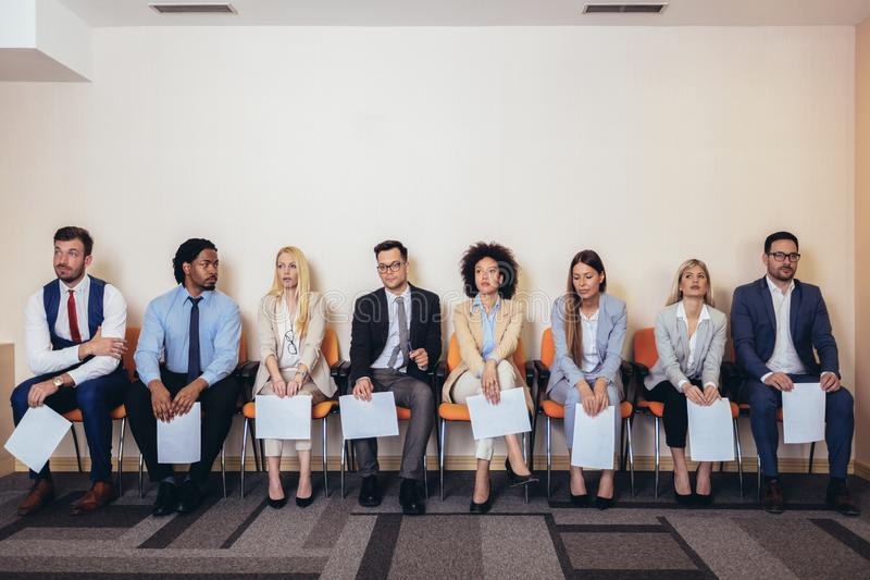 Photo of candidates waiting for a job interview. stock photo