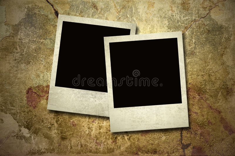 Photo cards on the grunge wall stock image