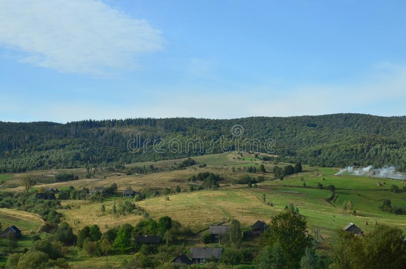 Photo of the Carpathian Mountains, which have a lot of coniferous trees. Forest and mountain landscape in the early autumn season.  stock photography