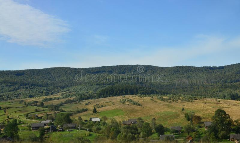 Photo of the Carpathian Mountains, which have a lot of coniferous trees. Forest and mountain landscape in the early autumn season royalty free stock image