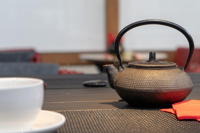 Photo of cast iron kettle under warm light royalty free stock photography
