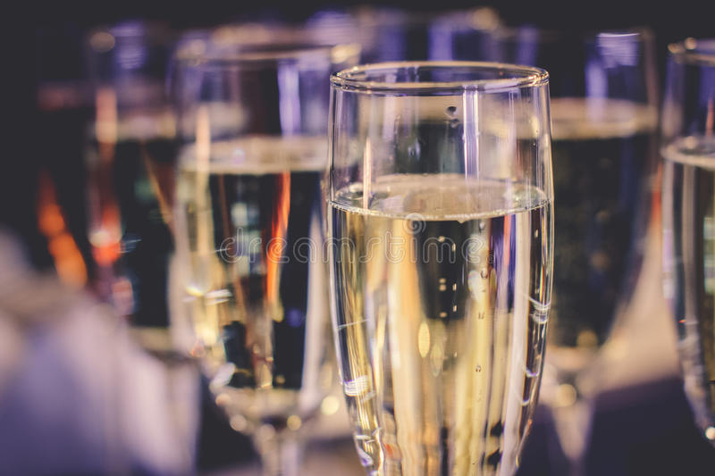 Photo of champagner glasses. On glass table with bokeh background royalty free stock photo