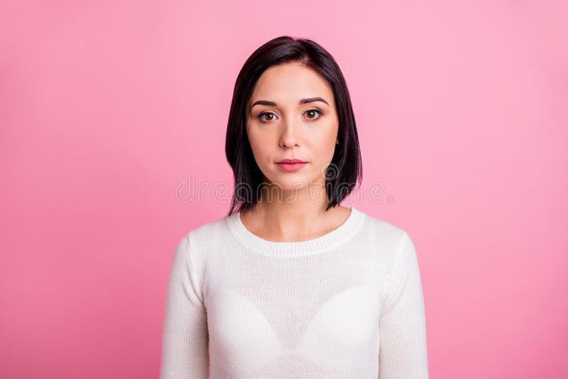 Photo of charming business lady with clever eyes attentively look on camera wear white pullover isolated pink color stock photography