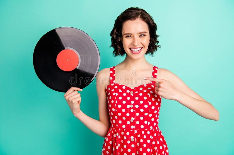 Photo of charming cool marvelous lovely nice cute girl holding vinyl plate and surprising that such stuff is still. Photo of charming cool marvelous lovely nice stock images