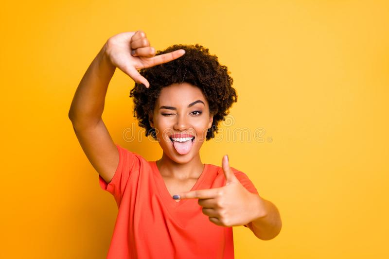 Photo of charming cut flirty black girlfriend showing you cadre frame pretending to be photographing tongue out blinking. Photo of charming cut flirty black royalty free stock images