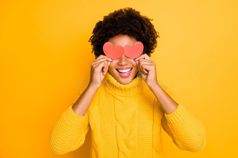 Photo of charming cute nice pretty sweet lovely girlfriend cheerful covering her eyes with two small red hearts wearing. Photo of charming cute nice pretty sweet stock image