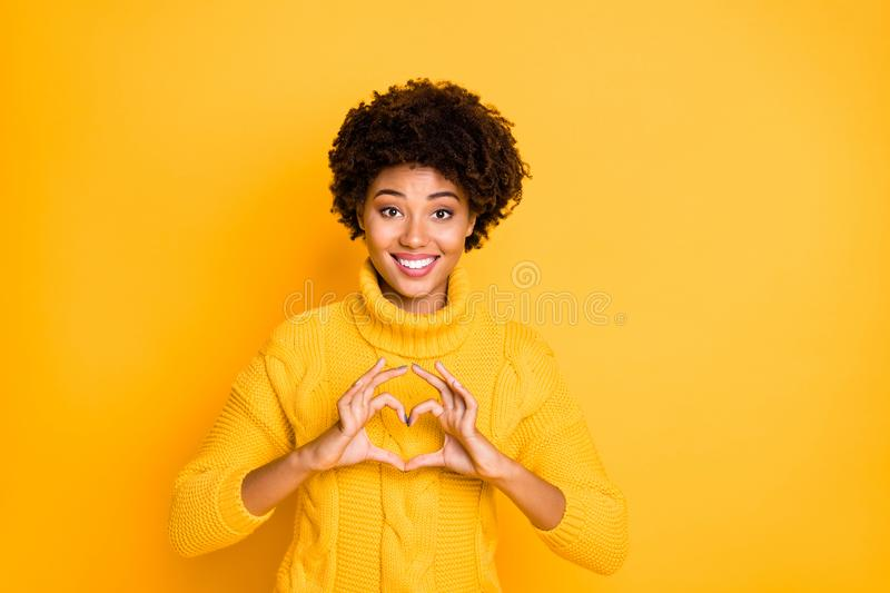 Photo of charming cute pretty sweet nice attractive black lady showing you heart shaped with fingers smiling toothily. Photo of charming cute pretty, sweet nice royalty free stock photo