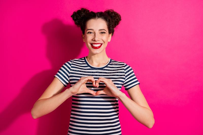 Photo of charming trendy cheerful cute nice fascinating girlfriend showing you heart shape sign isolated over fuchsia stock image