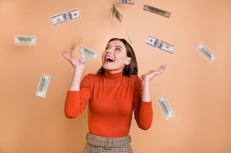 Photo of cheerful cute nice charming attorney earning large salary standing in cash rain wearing red turtleneck isolated. Photo of cheerful cute nice charming stock photos
