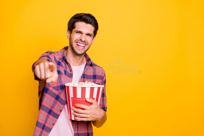 Photo of cheerful laughing rejoicing guy watching comedy movie with friends while isolated with yellow background. Photo of cheerful laughing, rejoicing guy stock photography