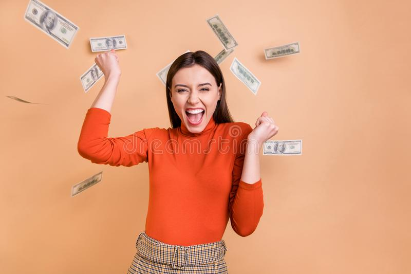 Photo of cheerful nice charming cute fascinating lawyer having received her wage living carefree wearing red turtleneck. Photo of cheerful nice charming, cute royalty free stock photos