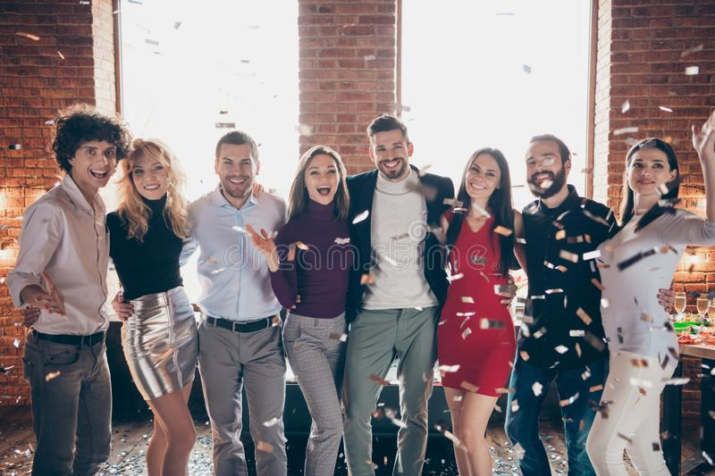 Photo of cheerful nice cute company of old friends wearing formally celebrating new year at corporate party in falling stock image