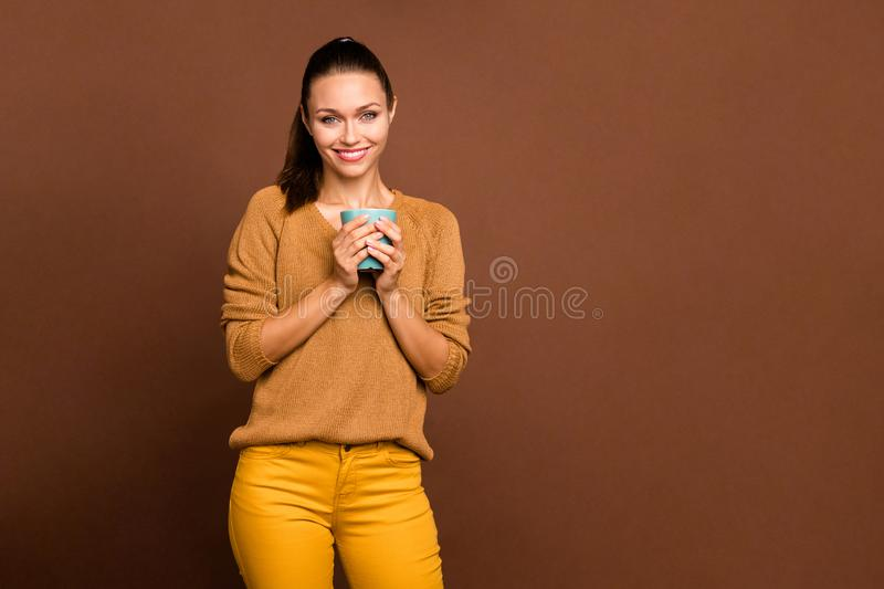 Photo of cheerful pleased charming cute nice attractive girlfriend holding cup of tasty tea with hands smiling toothily stock photos