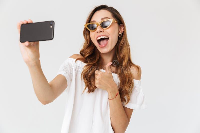 Photo of cheerful stylish woman 20s wearing sunglasses and jewel stock image
