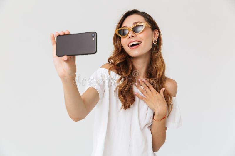 Photo of cheerful stylish woman 20s wearing sunglasses and jewel royalty free stock photography