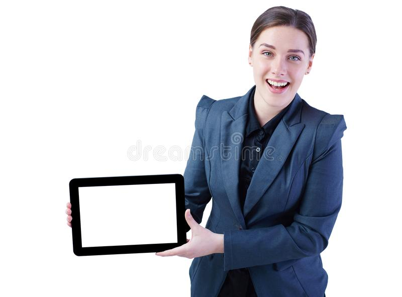 Cheerful young lady standing over white background showing display of tablet computer to camera. Focus on display. royalty free stock photo